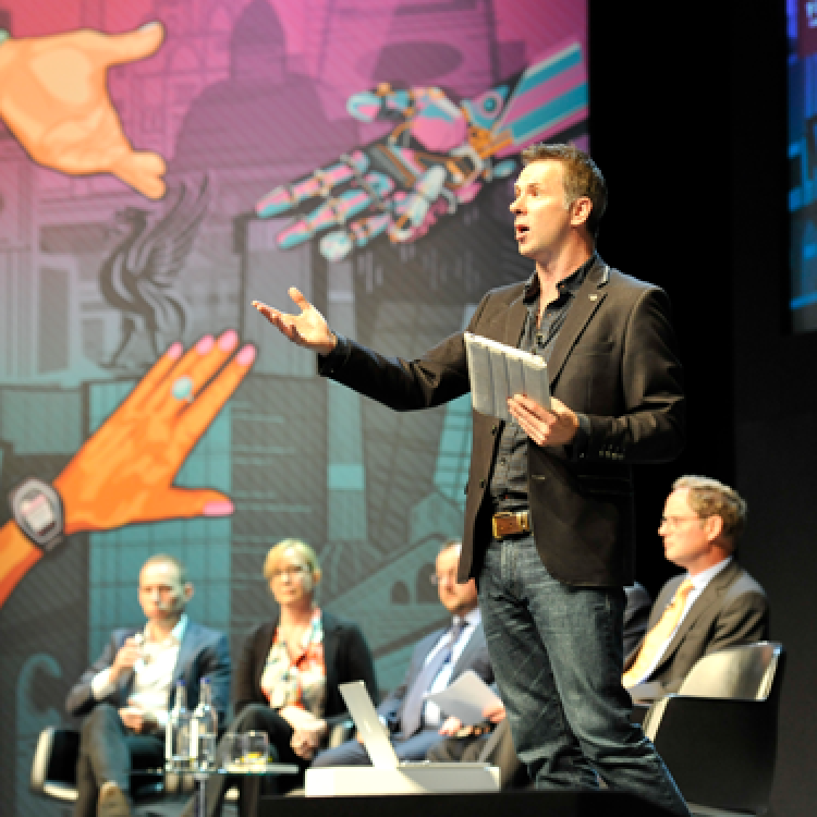 BBC presenter Spencer Kelly chaired the tech panel debate